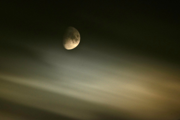 Moon through fast moving clouds